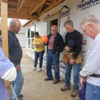 Volunteers Praying Before Build
